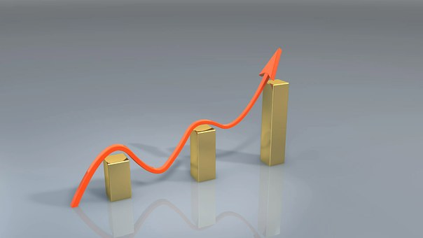 A picture of gold bars increasing in graph form symbolizing increase.